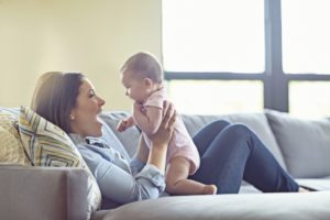 Mom and Baby on Couch- Lipsuction vs Tummy Tuck- Dr. Max Gouverne- Corpus Christi Moms Blog