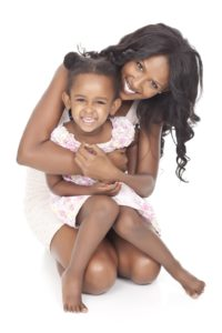 Mom and Daughter Smiling- Lipsuction vs Tummy Tuck- Dr. Max Gouverne- Corpus Christi Moms Blog