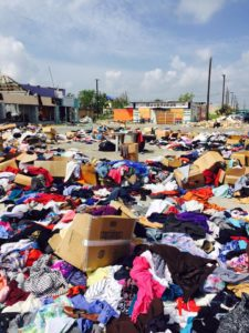 Hurricane Harvey disaster donations quickly piled up, littering the already-crumbling landscape.