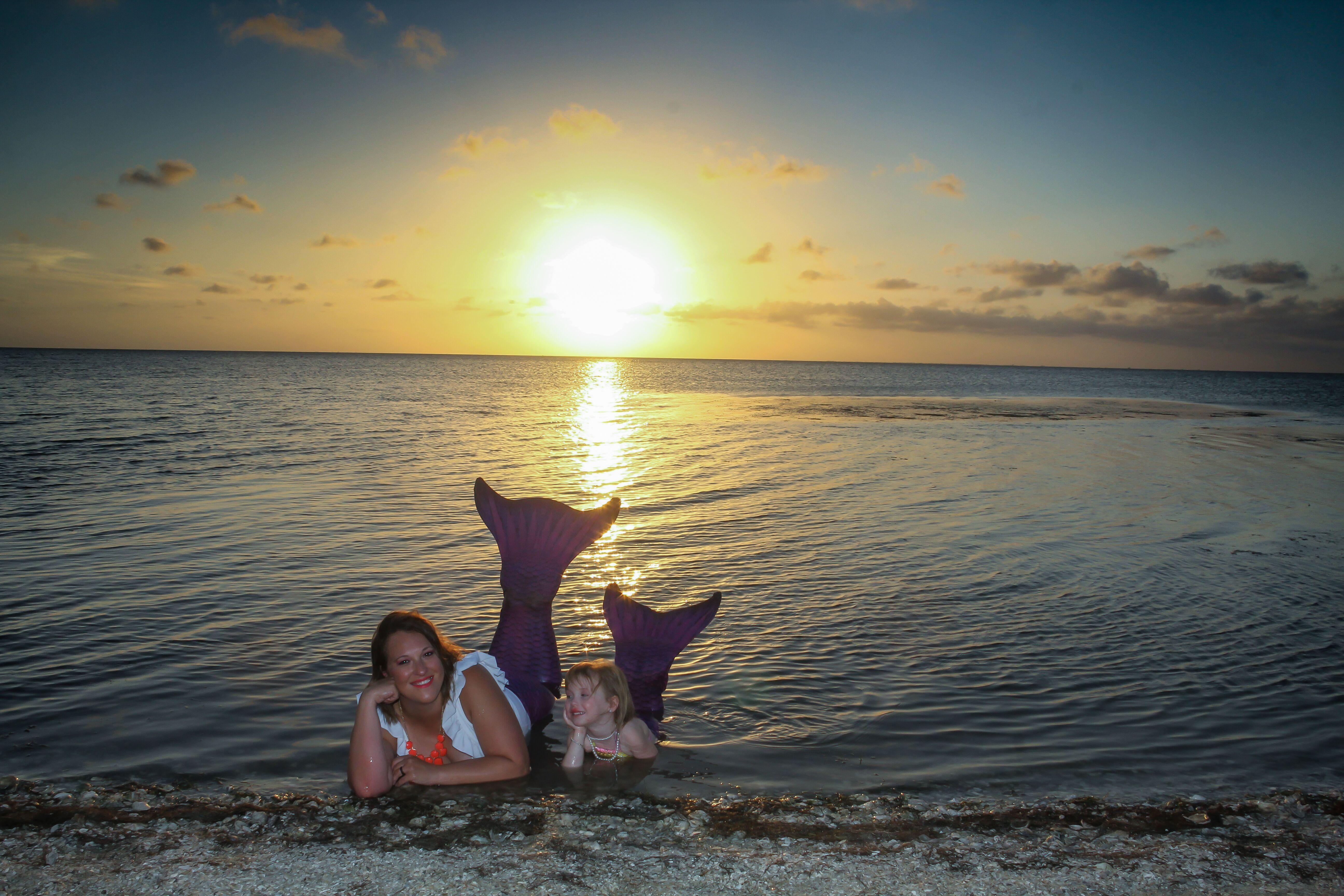 mermaids at sunset