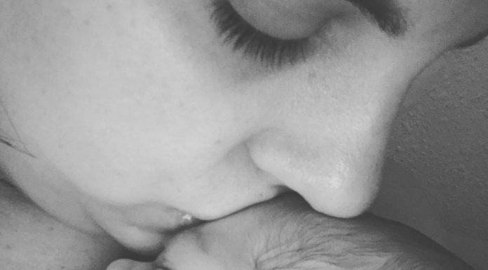 Mom kissing her baby : Coastal Bend Mom Collective