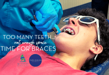 Image of a teenaged boy, wearing a dark pink t-shirt, laying in a dentists chair with white sunglasses on. A dentist is installing brackets for braces on his teeth. Title reads: Too many teeth, not enough space: Time for Braces | Kennedy Dental & Coastal Bend Mom Collective
